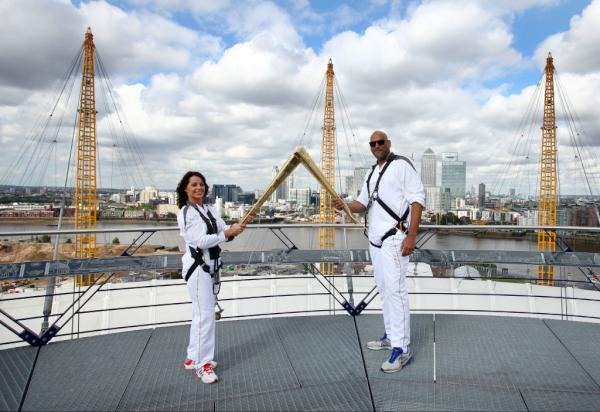Pic: John Amaechi &amp; Nadia Comaneci share a kiss atop North Greenwich Arena on Day 64 of the #London2012TorchRelay <a href=