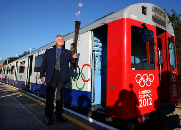 Pic: The Olympic Flame takes a ride on the London Underground (aka the Tube) on Day 67 of the #London2012TorchRelay <a href=