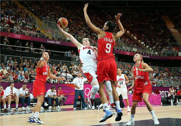Lindsay Whalen, No. 4, of United States attempts a shot against Marija Vrsaljko, No. 9, of Croatia during women's basketball on Day 1 of the London 2012 Olympic Games at the Basketball Arena on July 28, 2012, in London.