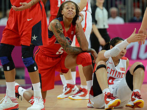 Chinese guard Miao Lijie, right, sits as U.S. guard Seimone Augustus looks on during the women's preliminary round group A basketball match China vs. USA of the London 2012 Olympic Games on Aug. 5, 2012 at the basketball arena in London. Augustus plays for the Minnesota Lynx. AFP PHOTO / TIMOTHY A. CLARY