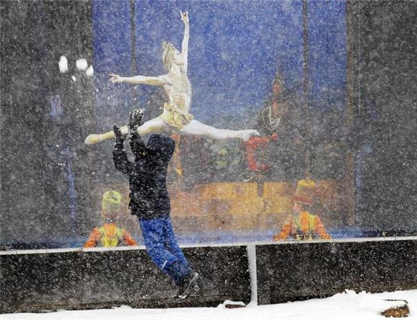 A boy throws a snow ball in the air as snow begins... | Reuters.com