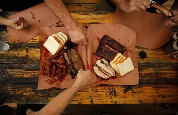 5662841 bytes; 5760 x 3736; The Texas BBQ Posse dives into a spread of sausage, brisket, ribs and turkey at La Barbecue in Austi