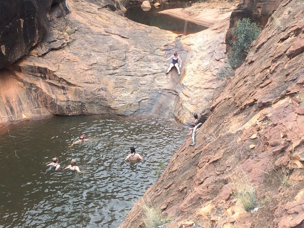 family in swimming hole
