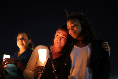 People attend a candlelight vigil for victims of the Route 91 music festival mass shooting next to the Mandalay Bay Resort and Casino in Las Vegas, Nevada, U.S. October 3, 2017. REUTERS/Lucy Nicholson