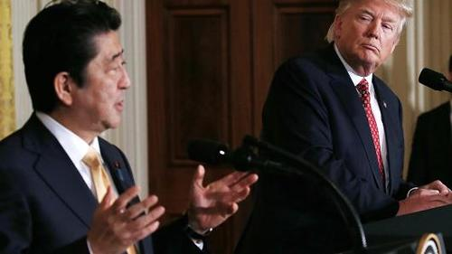 President Donald Trump (R) and Japanese Prime Minister Shinzo Abe hold a joint press conference at the White House on February 10, 2017 in Washington, DC.