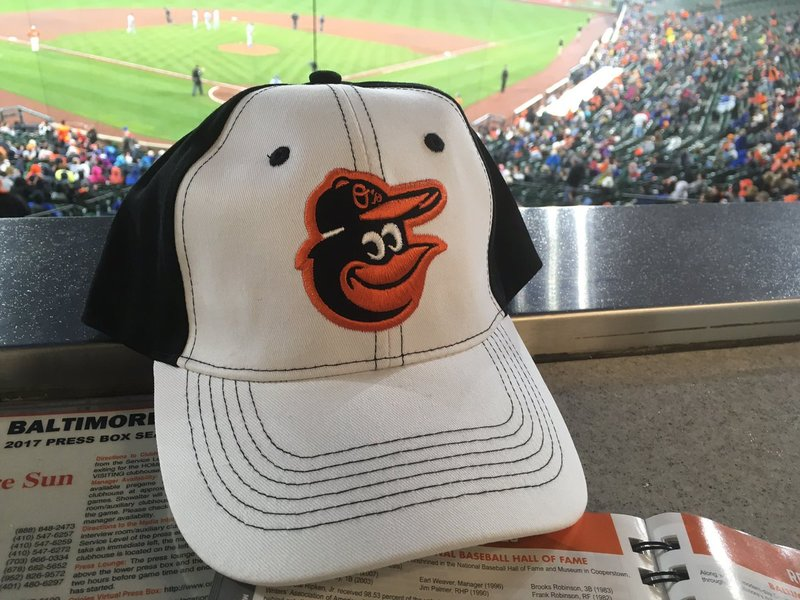 Orioles giving away these caps at tmrw's game to first 20k fans 15 and over. https