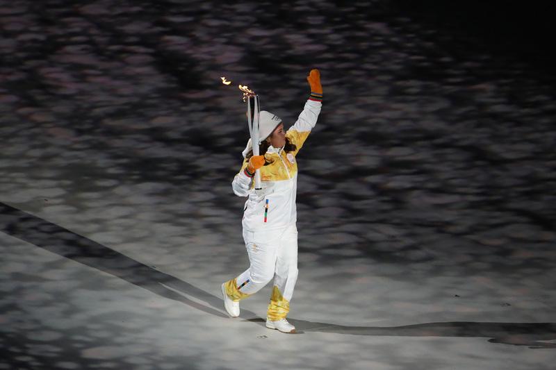 La antorcha olímpica, en su momento de llegada al estadio (Getty)