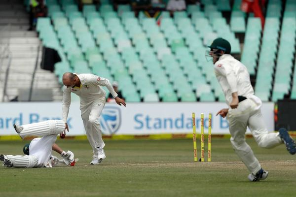Nathan Lyon looks down at AB de Villiers after running the South Africa batsman out at Kingsmead.
