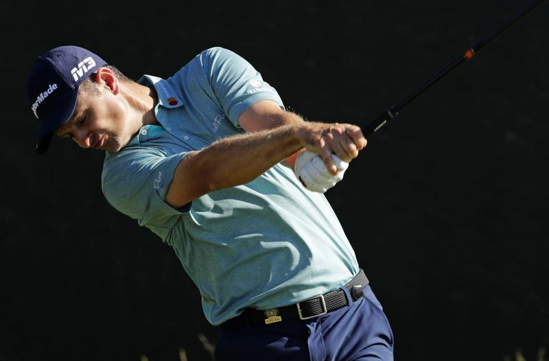 El inglés Justin Rose, campeón en 2013, firmó un buen 71