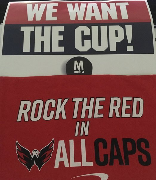 Posters being handed out outside Gallery Place by  wmata  fa9cf9137