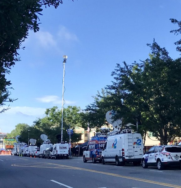 2686222a The national and local TV media are here for the #TrumpRallyOrlando , many  parked along South Division Avenue on the west side of @AmwayCenter .