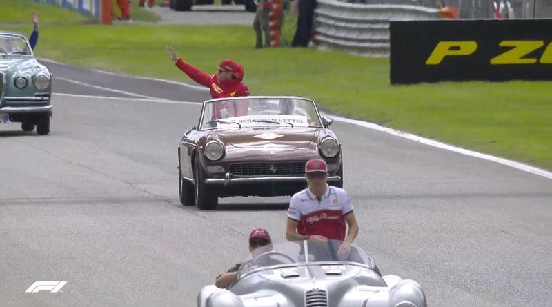 Raikkonen y Vettel saludan al público de Monza