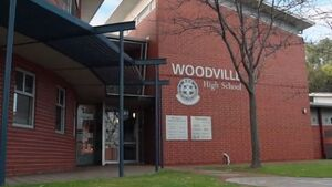A picture of a brick building that says Woodville High School