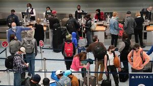A scene of an check in desk with people around it