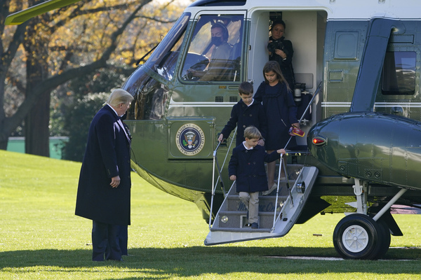 President Donald Trump watches as his grandchildren Theodore Kushner, Joseph Kushner and Arabella Kushner step off Marine One on the South Lawn of the White House