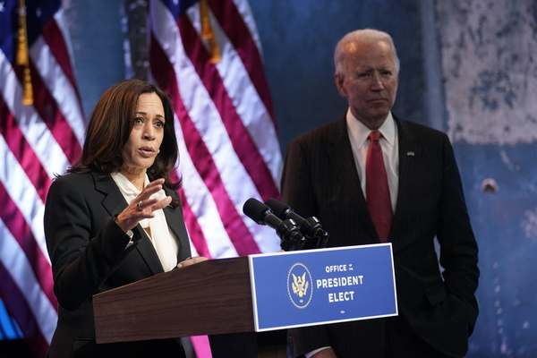 Vice President-elect Kamala Harris, accompanied by President-elect Joe Biden, speaks at The Queen theater