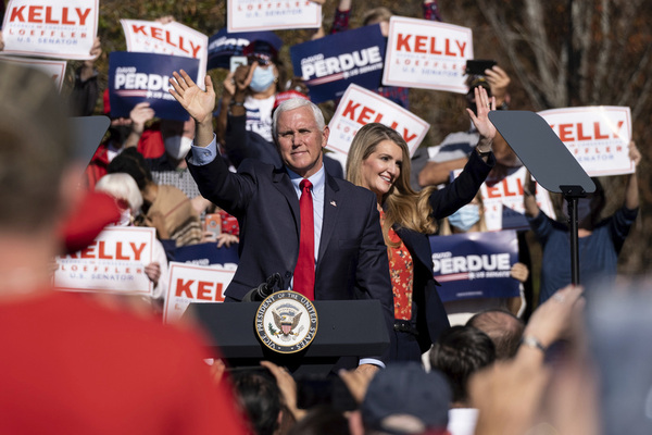 Vice President Mike Pence and Kelly Loeffler wave to the crowd during a Defend the Majority Rally in Canton