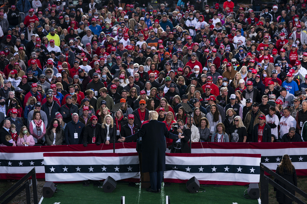 Donald Trump stages in front of a large crowd at a rally.
