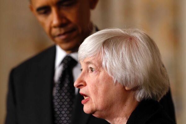 Janet Yellen talks to reporters with Barack Obama in the background