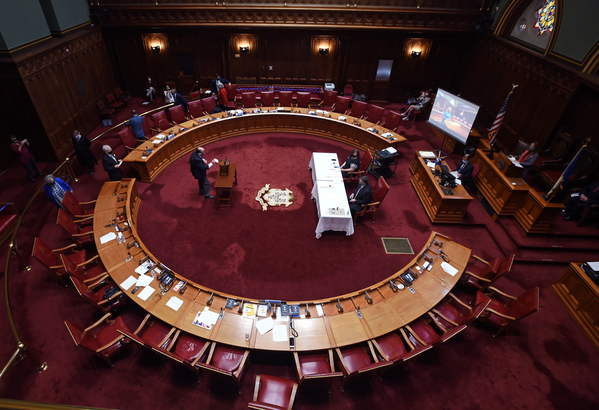 Connecticut's Presidential Electors convene on Monday, Dec. 14, 2020, in the Senate Chamber of the State Capitol in Hartford