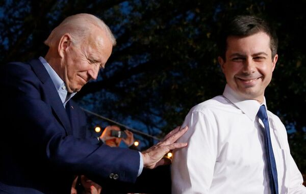 Joe Biden and Pete Buttigieg smile on stage together