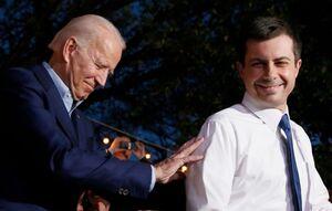 Joe Biden and Pete Buttigieg smile on stage together