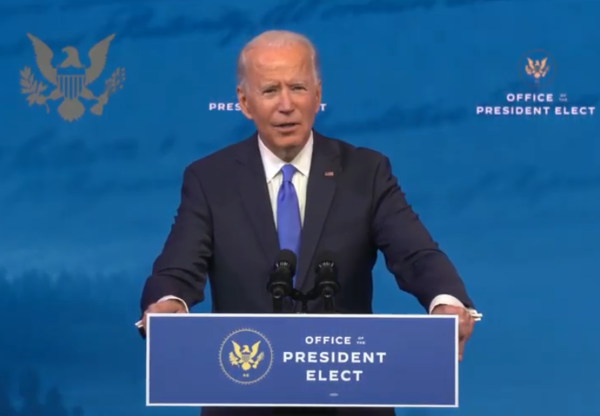 President elect Joe Biden talks at a podium