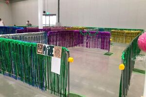 a maze made from crowd fencing and covered in tinsel.