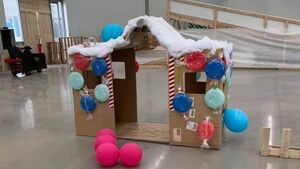 A gingerbread house made out of a cardboard box