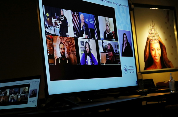 A video screen on display for members of the news media is seen featuring U.S. President-elect Joe Biden as he sits in a nearby room and participates in a video call with small business owners
