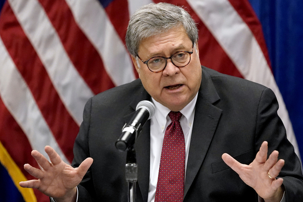US Attorney General William Barr gestures while speaking at a microphone