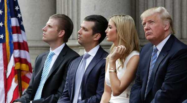 Donald Trump sits with his three adult children