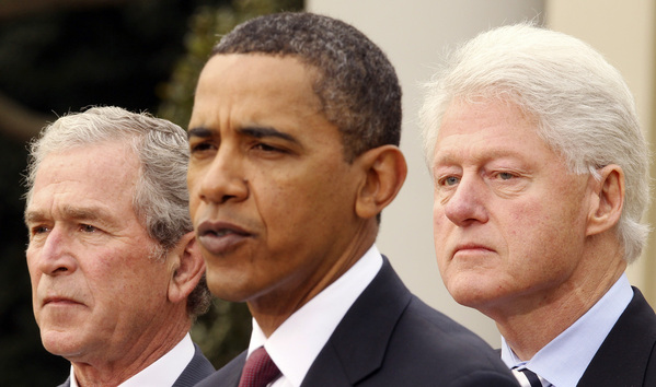 U.S. President Barack Obama is joined by former U.S. Presidents George W. Bush (L) and Bill Clinton (R) in the Rose Garden of the White House