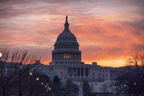 The US Capitol rotunda at sunset