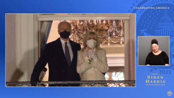 Joe Biden and Jill Biden watch fireworks from the White House balcony, in a screenshot from a YouTube video of the Celebrating America special