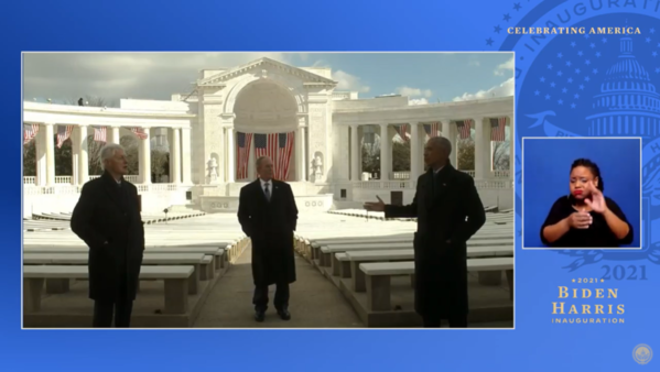 Bill Clinton, George W Bush and Barack Obama stand a few feet apart from each other in a courtyard, in a screenshot from a YouTube video of the Celebrating America special