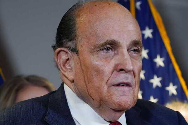 Donald Trump's lawyer Rudy Giuliani at a press conference