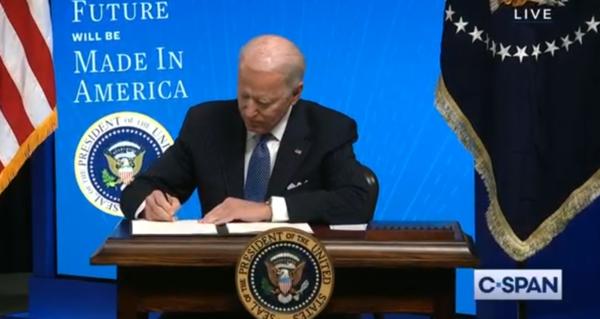 President Joe Biden signs an executive order