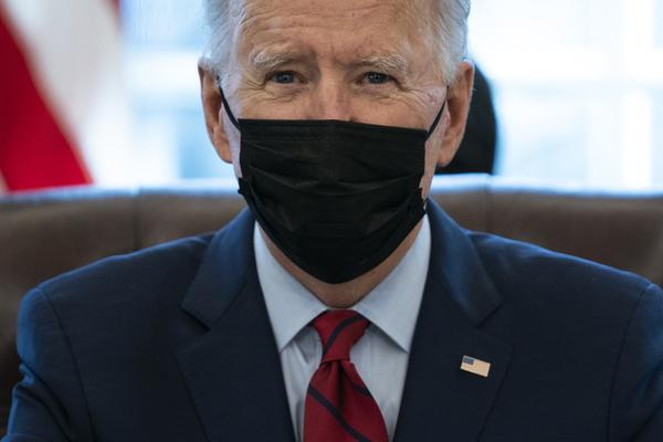 US President Joe Biden wears a mask