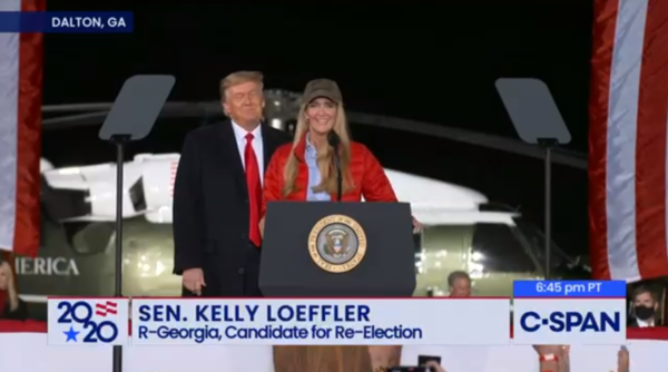 Kelly Leoffler on stage at a Trump rally