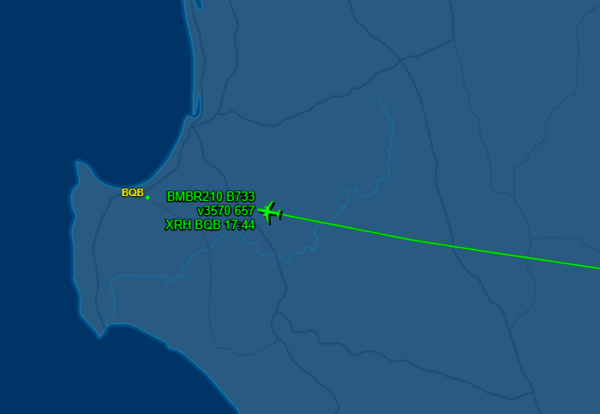 A flight tracker shows a blue map of WA with a green line displaying where a plane has travelled as it prepares to land at an airport marked.