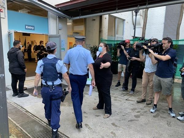 Police are ushered into a hospital