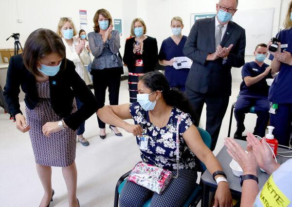 Gladys Berejiklian elbow-bumps a vaccine recipient