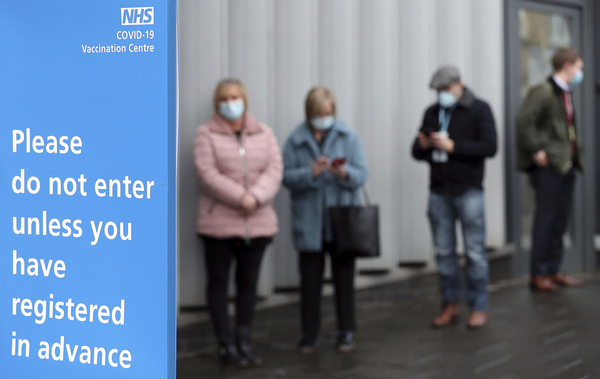A queue of people outside a hospital