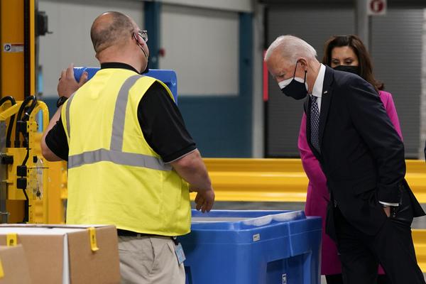 Joe Biden inspects a shipment of vaccines.