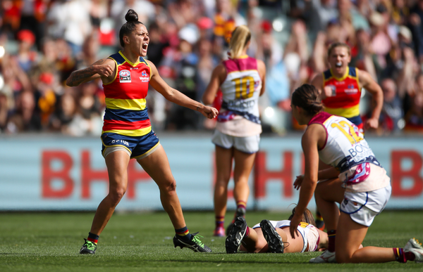 An Adelaide Crows AFLW player celebrates a goal.
