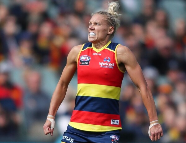 An Adelaide Crows AFLW player watches a kick.