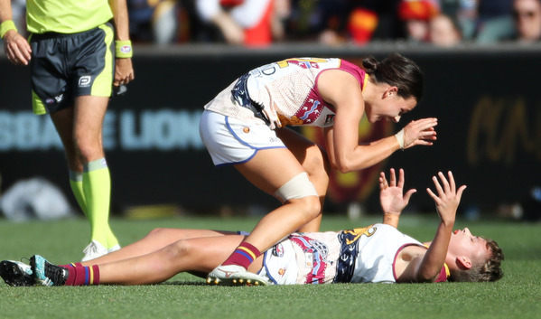 Two Brisbane Lions AFLW players celebrate the premiership victory.