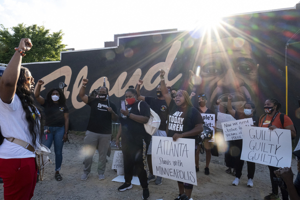 People gather before a march in Atlanta, Tuesday, April 20, 2021, after former Minneapolis police Officer Derek Chauvin was found guilty on all counts