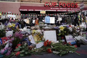 People gather at Cup Foods after a guilty verdict was announced at the trial of former Minneapolis police Officer Derek Chauvin for the 2020 death of George Floyd, Tuesday, April 20, 2021, in Minneapolis